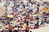 Holidaymakers sunbathing on the beach  — Stock Photo