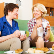 Women colleagues drinking tea and talking — Stock Photo #50939169