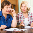 Sad aged women with documents — Stock Photo #50939367