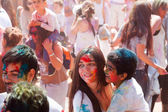 Woman with baby at  Festival  Holi Barcelona — Stock Photo