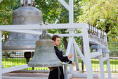 Monk is rings the bells of Dormition cathedral — Stock Photo