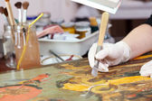 Restoration of  Christian icon with agate burnisher — Stock Photo