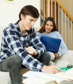 Young  students doing homework — Stock Photo