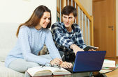 Student couple  doing homework with laptop   — Stock Photo