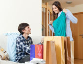 Happy  woman shopper and man with clothing  — Stock Photo
