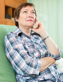 Stressed female pensioner on couch — Stock Photo