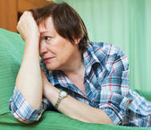 Stressed pensioner on couch — Stock Photo