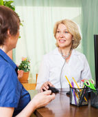 Positive doctor consulting female patient — Stock Photo