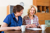 Notary officer helping aged client — Stock Photo