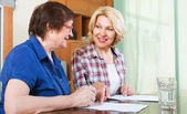 Notary officer helping mature client — Stock Photo