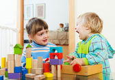Siblings  playing with blocks — Stock Photo