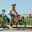 Father with child on bicycle — Stock Photo #50945649