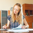Serious long-haired woman fills in documents — Stock Photo #50942191