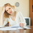 Sad woman with financial documents — Stock Photo #50942197