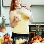 Happy woman drinking milk cocktail — Stock Photo #50942569