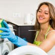 Housewife cleaning washing machine — Stock Photo #50945287