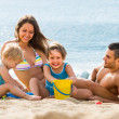 Family of four at the beach — Stock Photo #50945595