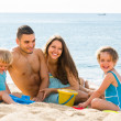 Family of four at the beach — Stock Photo #50945597