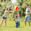 parents with children at sunny day — Stock Photo #50945663