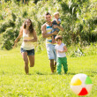 Постер, плакат: Parents with little daughters outdoor