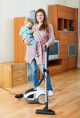 Woman  cleaning living room with vacuum cleaner — 图库照片
