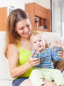 Happy woman with toddler on sofa — Stock Photo