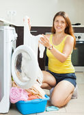Woman with white clothes near washing machine  — 图库照片