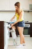 Family using washing machine   — Stock Photo