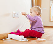 Toddler playing with electricity  — Stock Photo