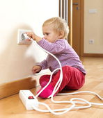 Toddler playing with electricity at home — 图库照片