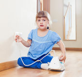 Child playing with electric iron — Stock Photo