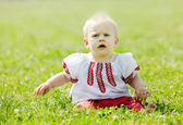 Baby in traditional folk clothes   — Stock Photo