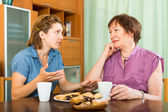 Pensioner having discussion with daughter — Stock Photo
