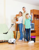 Family of three with  cleaning equipment — Stock Photo