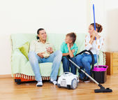 Family of three finished housework — Stock Photo