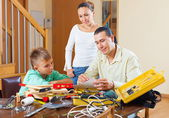 Ordinary family with working tools — Stockfoto