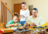 Family with working tools — Stockfoto