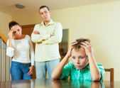 Parents and teen son after quarrel at home — Stock Photo