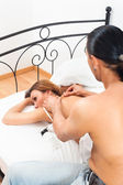 Man massaging his wife — Stock Photo