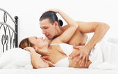 Middle-aged couple awaking together — Stock Photo
