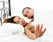 Couple caught  in bed — Stock Photo