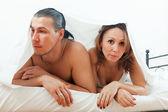 Unhappy couple under sheet   — Stock Photo