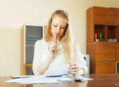 Wistful woman calculating something   — Stock Photo