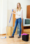 Positive long-haired girl washing parquet  — Stock Photo