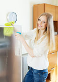 Positive blonde woman cleaning  glass   — Foto de Stock