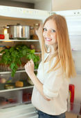 Woman looking for something in refrigerator — Stock Photo