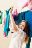Long-haired housewife drying clothes — Stock Photo