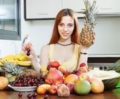 Long-haired woman with pineapple — Stock Photo