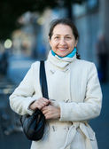 Mature woman in jacket — Stock Photo