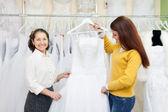 Women   at shop of wedding fashion — Stock Photo